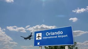 Airplane landing at Orlando Florida. Jet airplane landing in Orlando, Florida, USA. City arrival with airport direction sign. Travel, business, tourism and stock footage