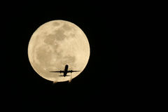 Jet Airplane Passing in front of a Full Moon- Real not Digitally Stock Photography