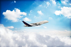 Jet airplane peaking through the clouds Stock Image