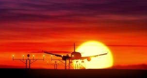 Jet airplane silhouette landing on sunset. Jet airplane silhouette landing at the airport during sunset. Sun, shape of plane and flashing runway lights stock video