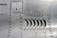 Jet Airplane Skin Detail. The metal skin of a jet fighter stock images
