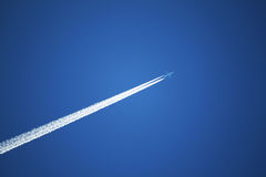 Jet Airplane Streams in the Sky Stock Photo