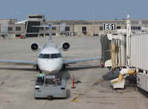 Jet airplane towed at airport Stock Photo