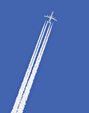 Jet airplane with trail Royalty Free Stock Photo