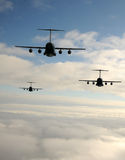 Jet airplanes in flight. Three military transport jets in flight rear view stock photo