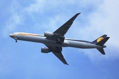 Jet Airways Boeing 777 descending for landing at JFK International Airport in New York. NEW YORK - SEPTEMBER 27, 2015: Jet Airways Boeing 777 descending for Royalty Free Stock Images