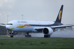 Jet Airways landed on runway. Jet Airways doing taxi on runway airport, JetAirways royalty free stock photography