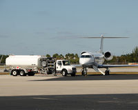 Jet being fueled. Modern business jet on a tarmac for fueling Stock Photo