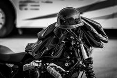 Helmet on Handlebars. Jet Black motorcycle helmet on handlebars Royalty Free Stock Photos