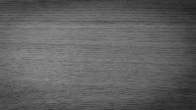 JET BLACK WOOD DESK TEXTURE. The texture of Jet black wooden desk Royalty Free Stock Photos