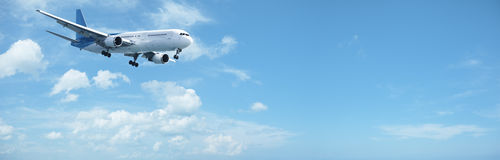 Jet in a blue sky Stock Photography