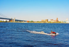 Jet boat near Benjamin Franklin Bridge over Delaware River Royalty Free Stock Photography