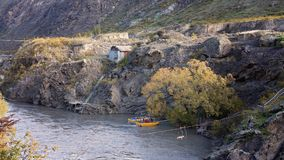 A Jet Boat Prepares To Launch In Shotover River. Canyon with historic hut built into the cliffs Stock Image