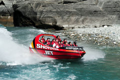 Jet Boat in Queenstown New Zealand. QUEENSTOWN,NZ - FEB 20: Tourists enjoy a high speed jet boat ride on the Shotover River on February 20, 2009 in Queenstown Stock Photography