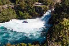 A jet boat with tourists at Huka Falls, New Zealand Royalty Free Stock Photography