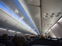 Jet cabin full of passengers Royalty Free Stock Photo