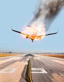 Jet carrier and engine on fire. Near airport Stock Photo