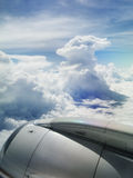 Jet and Cloud. View of jet plane engine with cloud patterns stock images