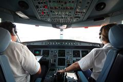 Jet cockpit. Jet airplane cockpit with two pilots crewmembers stock images
