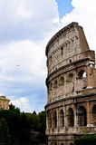 A Jet and the Colosseum. A jet flying near the Colosseum, ancient and nowadays in a same picture Royalty Free Stock Photos