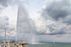 The Jet d`Eau fountain. Water-jet fountain in lake Geneva in Switzerland, one of the most famous landmarks of the city Stock Photo