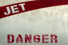 Jet danger. Danger stenciled onto side of jet intake in red letters royalty free stock image