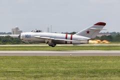 Jet de MIG avec le feu d'échappement Photographie stock libre de droits