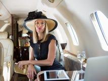 Jet de Rich Woman Sitting In Private photo libre de droits
