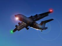 Jet en la noche Imagenes de archivo