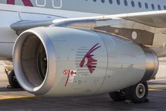 Jet engine, Airbus A320 of Qatar Airways. DOHA, QATAR - October 05, 2013: Jet engine, Airbus A320 of Qatar Airways. Airliner on a airfield Royalty Free Stock Image