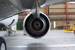 Jet engine at aircraft. In the hangar, back view Royalty Free Stock Photo
