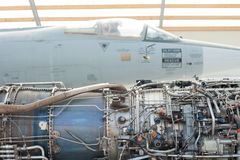 Jet engine and airplane. Jet engine next to the airplane Royalty Free Stock Images