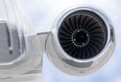 Jet engine closeup on a private airplane - Bombardier. Jet Engine closeup on a modern private jet airplane - Bombardier Global Express Stock Photo