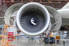 Jet engine open and ready for maintenance inside hangar Stock Photos
