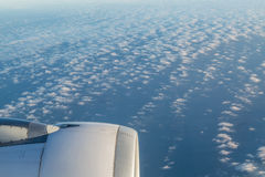 Jet engine over clouds Royalty Free Stock Photography