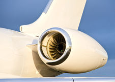 Jet Engine on a Private Plane - Bombardier. Jet Engine with a part of a wing on a Private Plane - Bombardier Global Express stock photography