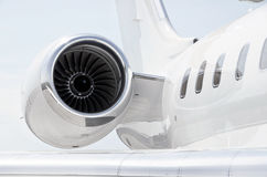 Jet Engine on a Private Plane - Bombardier. Jet Engine with a part of a wing on a luxury private aircraft - Bombardier Global Express Royalty Free Stock Images