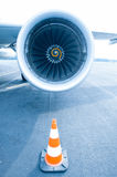 Jet engine with traffic cone in front Stock Images