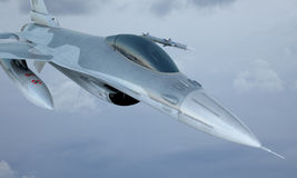 Jet F-16 fly in the sky , american military fighter plane.  USA army.  Royalty Free Stock Photo