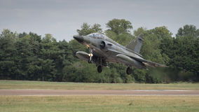 Jet fighter aircraft landing on runway Royalty Free Stock Photo