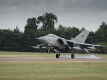 Jet fighter aircraft landing on runway Royalty Free Stock Photography