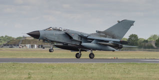 Jet fighter aircraft landing on runway Stock Image