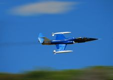 Jet fighter airplane. Jet flying at high speed with motion blur background royalty free stock photos