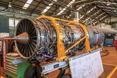 Jet fighter engine. Exposed engine of an F16 fighter jet inside a maintenance hangar Royalty Free Stock Photo