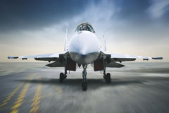 Jet fighter landing on the carrier deck. Image of jet fighter landing on the carrier deck with blur motion Royalty Free Stock Photography