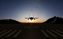 Jet fighter. Silhouette flights and sunset background Royalty Free Stock Images