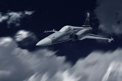 Jet fighter war airplane flying at night for an attack mission Royalty Free Stock Photos