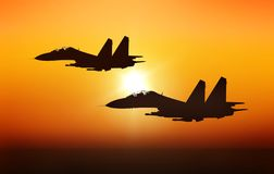 Jet fighters. On sunset background Stock Photo