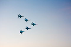 Jet fighters at the airshow. Flying in blue sky Royalty Free Stock Images