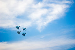 Jet fighters at the airshow moving upward. In beautiful blue sky Stock Images